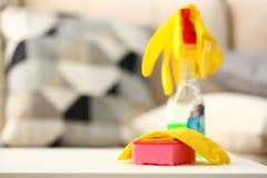 Yellow house glove lying on pink sponge as symbol of chore routine work. Closeup stock photos
