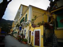 yellow house in greek in summer royalty free stock photos