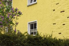 Yellow house with holes in Moselkern, Germany stock images