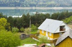 Yellow house lake Bicaz Romania Royalty Free Stock Photos