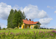 Yellow house with a red roof Royalty Free Stock Photo