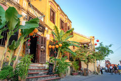 Yellow house on riverside, Hoi An, Vietnam. Hoi An is located on the coast of the South China Sea. Is recognised as a World Heritage Site by UNESCO. Market at stock image