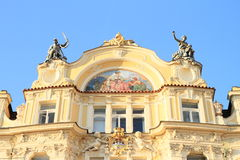 Yellow house with statues and painting Royalty Free Stock Images