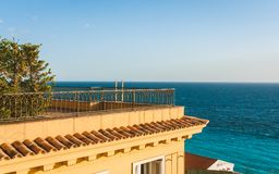 Yellow house and blue sea in Nice. Yellow house with view of beautiful seascape from its roof in Nice, Cote d`Azur, France royalty free stock photos