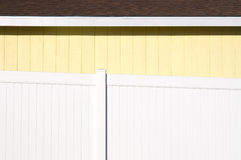 Yellow House with White Fence Stock Image