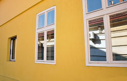 Yellow house with windows stock images