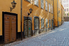 Yellow houses in Old Town. Yellow houses on a cobblestone street in Old Town, Stockholm royalty free stock image