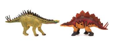 Yellow huayangosaurus  and red stegosaurus toys on white background Royalty Free Stock Photo