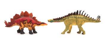 Yellow huayangosaurus  and red stegosaurus toys on white Stock Photography