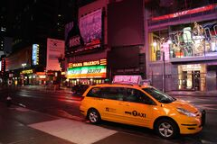 Yellow Hvc Taxi on Road during Night stock images