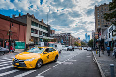Yellow Hybrid Electric Taxi in Greenwich Village, NYC royalty free stock photography