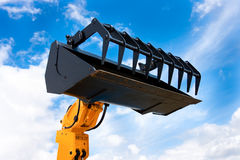 Yellow Hydraulic Excavator Black Grab Bucket Royalty Free Stock Photos