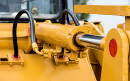 Yellow hydraulic pipe Stock Images