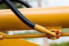 Yellow hydraulic pipe Stock Image