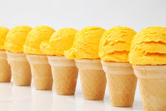 Yellow ice cream cones in a row Royalty Free Stock Photography