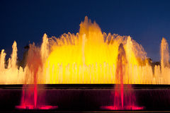 Yellow illuminated fountain in the evening light of Barcelona Royalty Free Stock Photography