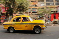 Yellow Indian taxi Stock Images