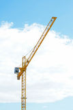 Yellow Industrial crane and blue sky on construction site Royalty Free Stock Image