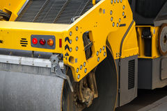 Yellow industrial roller, urban road is under construction Royalty Free Stock Photography