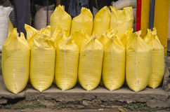 Yellow industrial sack in asia street market Stock Photos