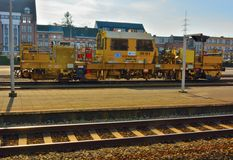 Yellow industrial train equipment Royalty Free Stock Photos