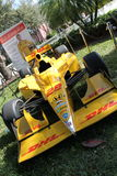 Yellow indycar race car. Modern racing car. Dallara DW12 Indycar racecar piloted by Ryan Hunter Reay on display outdoors in sunny south Florida Stock Image