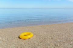 Yellow inflatable paddling circle Stock Image