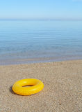 Yellow inflatable paddling circle Stock Images