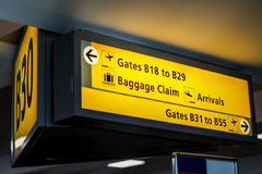 Yellow information sign in a airport terminal Stock Images