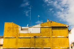 Yellow insulating material on building in Granada, Spain royalty free stock photos