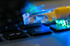 Free Yellow Internet Cable On Laptop Computer Keyboard Royalty Free Stock Photos - 120976238