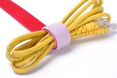 Yellow internet data cable warp. Red velcro warp the web cable Stock Photo