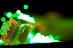 Yellow internet switch close up macro shot on computer circuit board. Green optical fibres Stock Photography