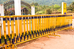 Yellow iron fence. Royalty Free Stock Photography
