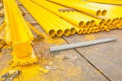 Yellow iron pipe. Pile of new yellow iron pipe Royalty Free Stock Photos