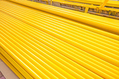 Yellow iron pipe. Pile of new yellow iron pipe Royalty Free Stock Photography