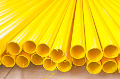 Yellow iron pipe. Pile of new yellow iron pipe Stock Photography