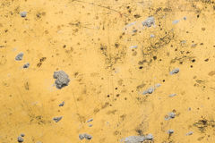 Yellow iron wall. With traces of cement Stock Image
