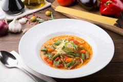 Yellow italian minestrone soup served with food ingredients royalty free stock image