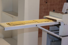 Free Yellow Italian Taralli Preparation With Food Machine: Traditional Snack Royalty Free Stock Photo - 94300165