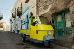 Yellow Italian three-wheels van stock photo