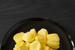 Yellow jack fruit on black and white wood background , clipping path Royalty Free Stock Image