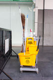 Yellow janitor cart. Royalty Free Stock Photos