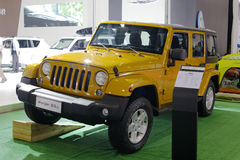 Yellow jeep wrangler car Royalty Free Stock Images