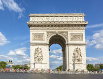 Yellow Jersey in Paris - Tour de France 2016. Paris, France - July 24, 2016: ChrissFroome of Team Sky wearing the Yellow Jersey passing by the Arch de Triomphe Stock Photo