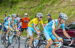 The Yellow Jersey - Vincenzo Nibali. Col du Tourmalet, France- July 24, 2014: The leader Vincenzo Nibali wearin the Yellow Jersey rides between his teammates on Stock Photography
