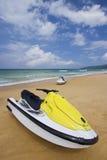 Yellow Jetski on the beach. Stock Images