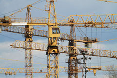 Yellow jib cranes Stock Photo