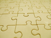 Yellow jigsaw Stock Images