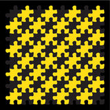 Yellow jigsaw puzzle pieces on black background Stock Photo